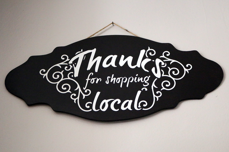 """Thanks for shopping local"" sign"