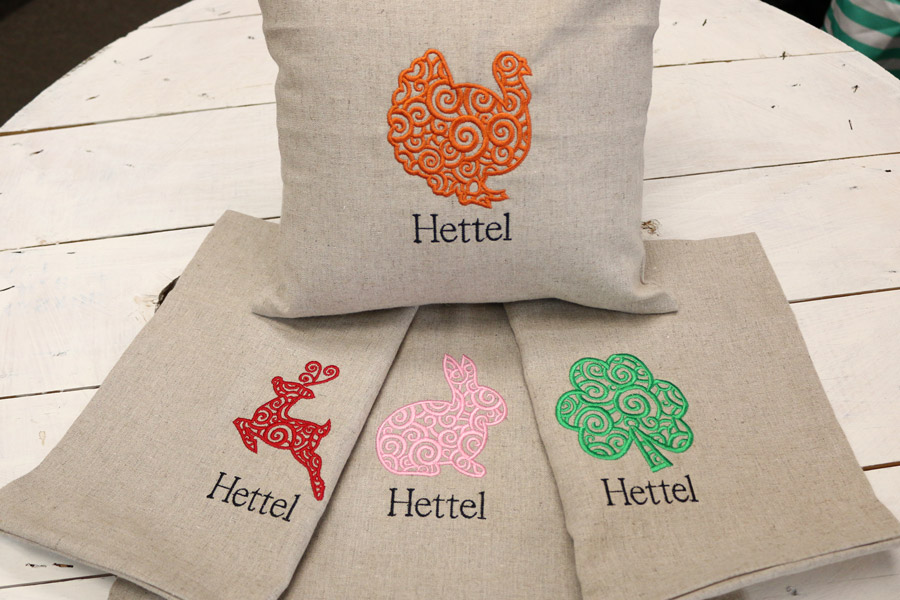 embroidery service shown on pillows